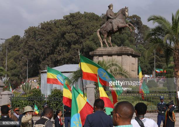 Ethiopians with flags attend an event to mark the 122nd Anniversary of Ethiopia's Battle of Adwa at King II Menelik Square in Addis Ababa on March 02...