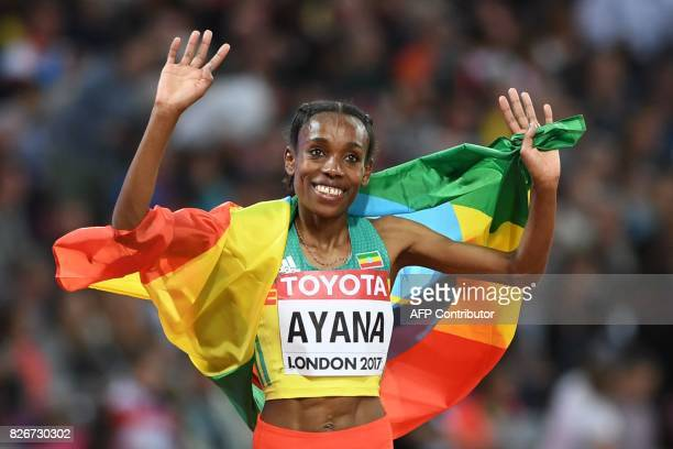 Ethiopia's Almaz Ayana celebrates after winning the final of the women's 10,000m athletics event at the 2017 IAAF World Championships at the London...