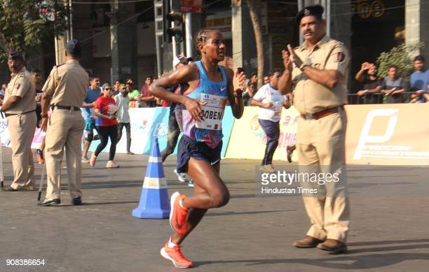 Ethiopia's Amane Gobena who won the women's category of Mumbai Marathon at the finishing line on January 21 2018 in Mumbai India