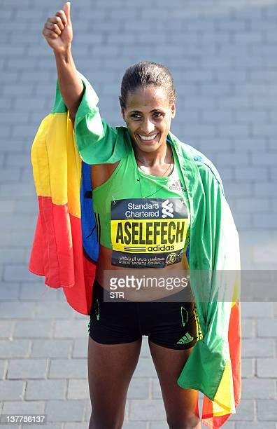 Ethiopia's Aselefech Mergia Medessa celebrates after winning the women's Dubai Marathon in the Gulf emirate on January 27 2012 AFP PHOTO/STR