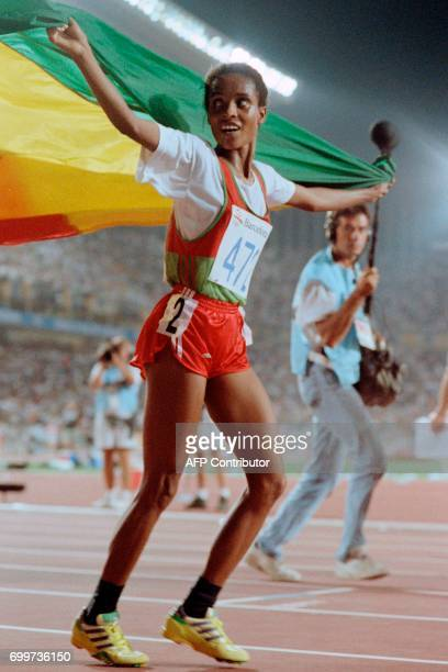 Ethiopia's Derartu Tulu celebrates after winning the women's 10000m final at the athletics event during the Barcelona 1992 Olympic Games on August 7...