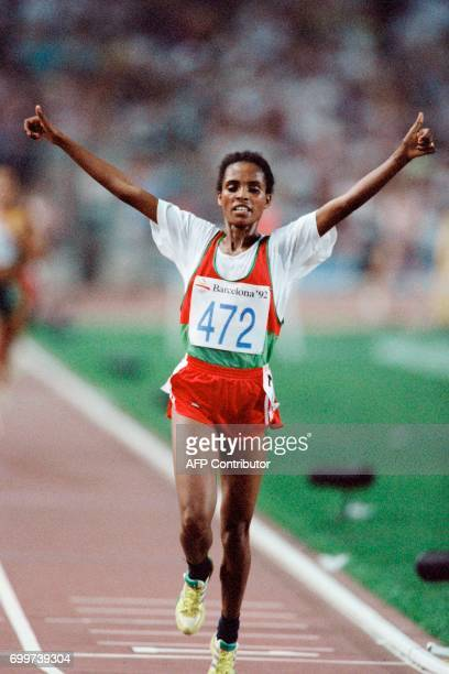 Ethiopia's Derartu Tulu celebrates as she finishes the women's 10000m final at the athletics event during the Barcelona 1992 Olympic Games on August...