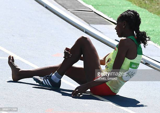TOPSHOT Ethiopia's Etenesh Diro reacts after she competed in the Women's 3000m Steeplechase Round 1 during the athletics event at the Rio 2016...