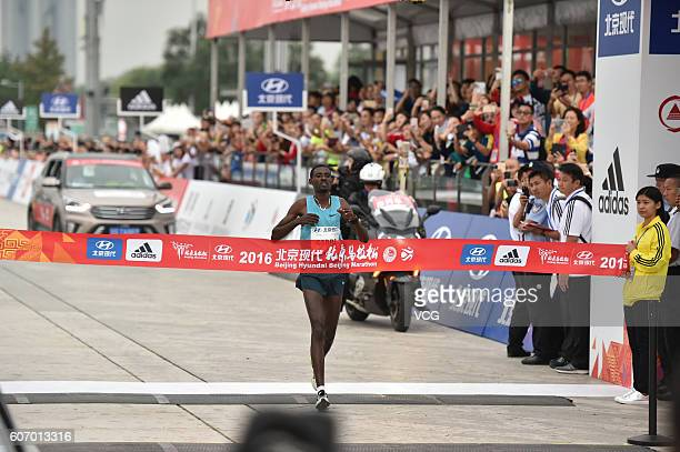 Ethiopia's Gebre Gebremariam comes to the finishing line during the 2016 Beijing Marathon on September 17 2016 in Beijing China Running from the...