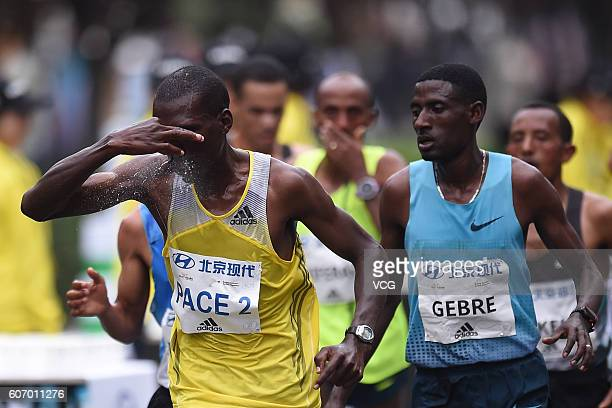 Ethiopia's Gebre Gebremariam competes running during the 2016 Beijing Marathon on September 17 2016 in Beijing China Running from the Tian'anmen...