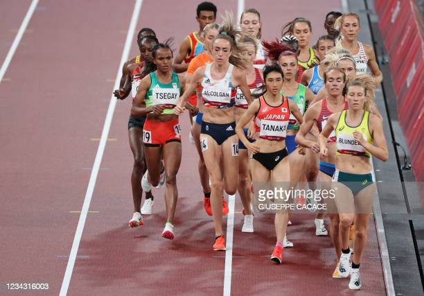 Ethiopia's Gudaf Tsegay, Britain's Eilish McColgan, Japan's Nozomi Tanaka and Australia's Jenny Blundell compete in the women's 5000m heats during...