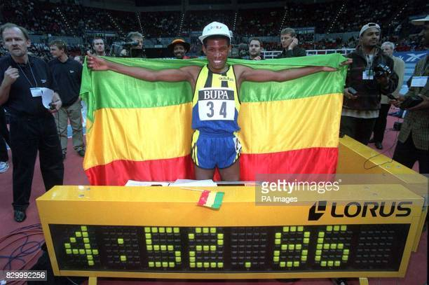 Ethiopia's Haile Gebrselassie celebrates destroying the world indoor 2000 metres record at the BUPA Grand Prix in Birmingham today The Olympic and...