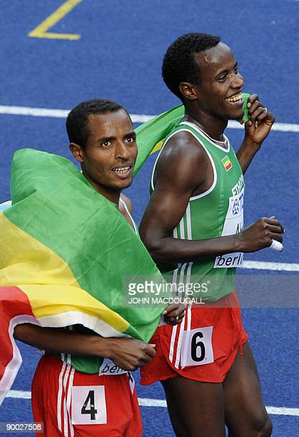 Ethiopia's Kenenisa Bekele and Ethiopia's Ali Abdosh celebrate after the men's 5000m race of the 2009 IAAF Athletics World Championships on August 23...
