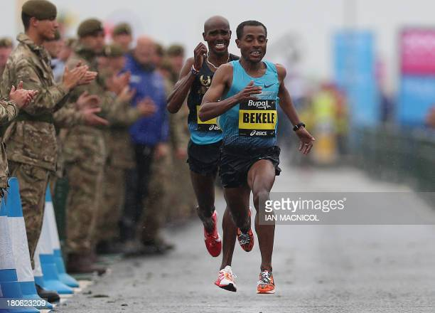 Ethiopia's Kenenisa Bekele leads Britain's Mo Farah as they charge to the finish line of the Great North Run half marathon in South Shields near...