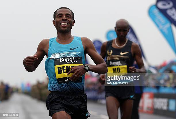 Ethiopia's Kenenisa Bekele wins the Great North Run half marathon as he crosses the finish line ahead of Britain's Mo Farah in South Shields near...