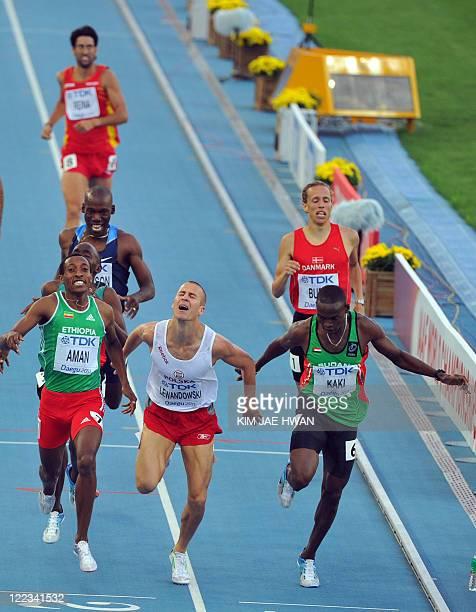 Ethiopia's Mohammed Aman Poland's Marcin Lewandowski and Sudan's Abubaker Kaki finish their men's 800 metres semifinal at the International...
