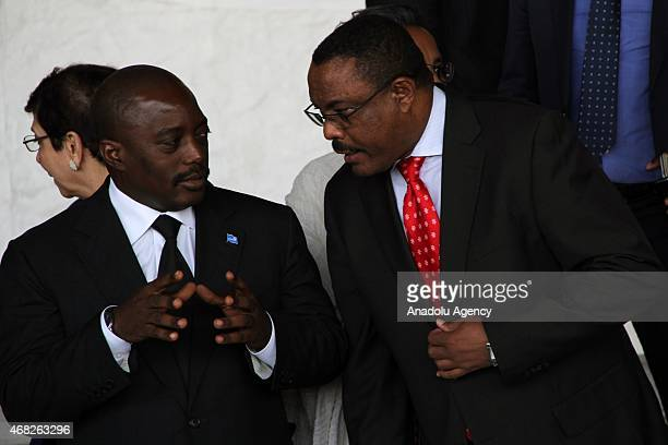 Ethiopia's new leader Hailemariam Desalegn and Joseph Kabila President of Democratic Republic of the Congo chat during the closure session of the...