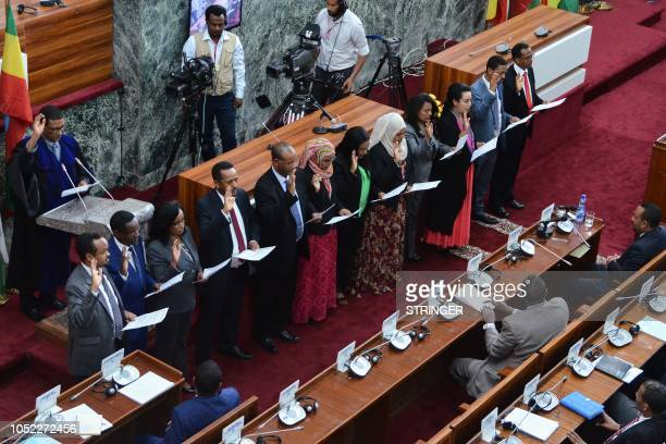 Ethiopia's newly appointed ministers take their oath of office on October 16 at the parliament in the capital Addis Ababa Ethiopian Prime Minister...