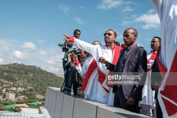 Ethiopia's Prime Minister Abiy Ahamed gestures during a visit to the University of Gondar in Gondar northern Ethiopia on November 9 2018 The...