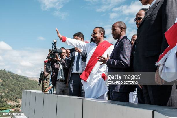 Ethiopia's Prime Minister Abiy Ahamed waves to students during his visit to the University of Gondar in Gondar northern Ethiopia on November 9 2018...