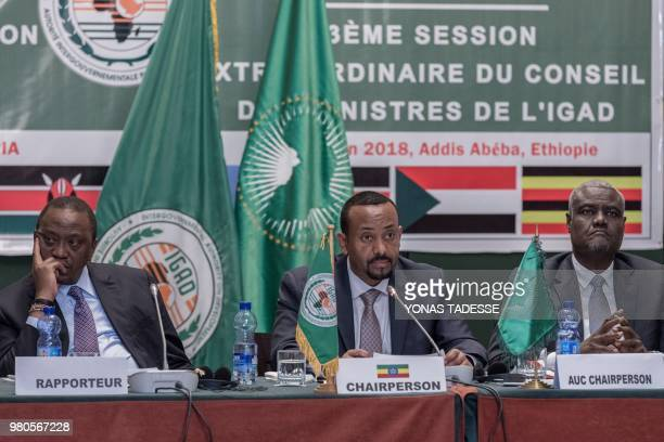 Ethiopia's Prime Minister Abiy Ahmed African Union Commission Chairman Moussa Faki and Kenya's President Uhuru Kenyatta attend the 32nd Extraordinary...