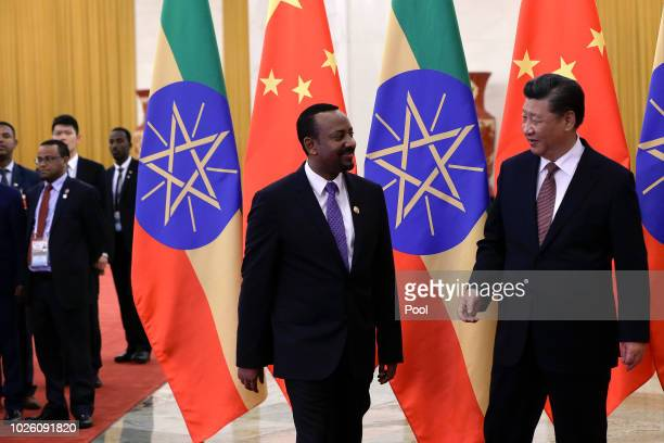 Ethiopia's Prime Minister Abiy Ahmed and Chinese President Xi Jinping proceed to their bilateral meeting at the Great Hall of the People on September...