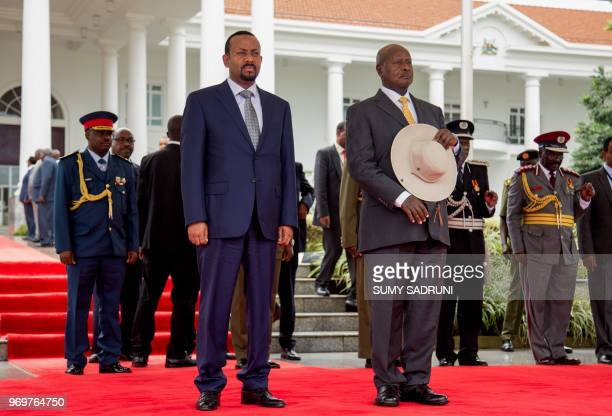 Ethiopia's Prime Minister Abiy Ahmed and Uganda's President Yoweri Museveni attend a welcome ceremony for his twoday state visit at State House in...