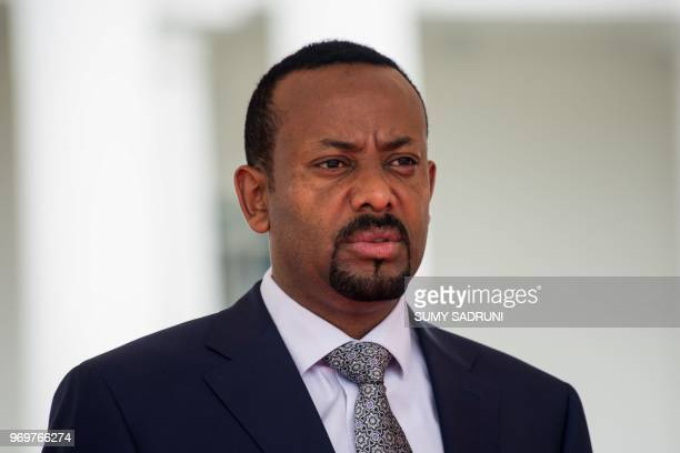 Ethiopia's Prime Minister Abiy Ahmed attends a welcome ceremony for his two-day state visit at State House in Entebbe on June 8, 2018.