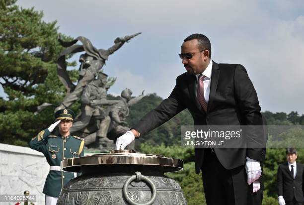 Ethiopia's Prime Minister Abiy Ahmed burns incense as he visits the National Cemetery in Seoul on August 26, 2019. - Ahmed arrived in Seoul on August...