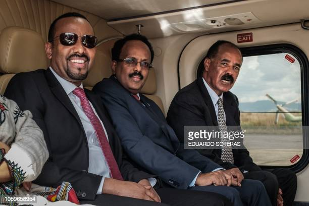 Ethiopia's Prime Minister Abiy Ahmed Eritrea's President Isaias Afwerki and Somalia's President Mohamed Abdullahi Mohamed sit in a helicoptor during...