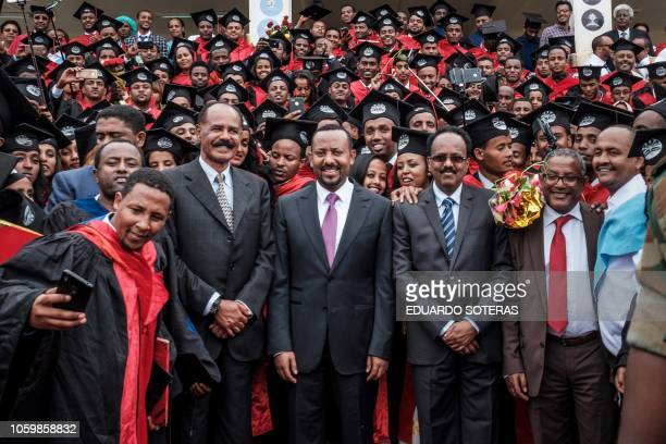 Ethiopia's Prime Minister Abiy Ahmed Eritrea's President Isaias Afwerki and Somalia's President Mohamed Abdullahi Mohamed join a graduation ceremony...