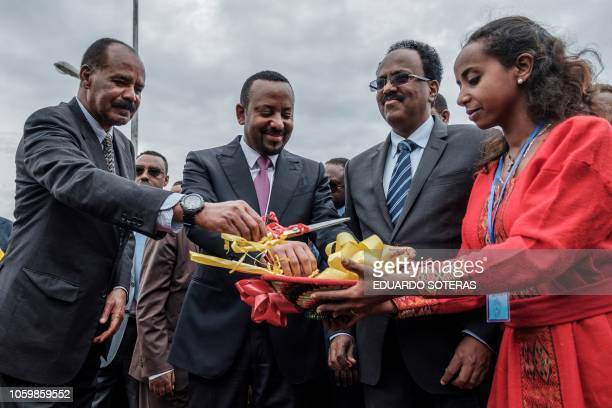 Ethiopia's Prime Minister Abiy Ahmed Eritrea's President Isaias Afwerki and Somalia's President Mohamed Abdullahi Mohamed cut a ribbon during the...