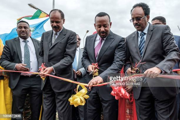 Ethiopia's Prime Minister Abiy Ahmed , Eritrea's President Isaias Afwerki and Somalia's President Mohamed Abdullahi Mohamed cut the ribbon during the...