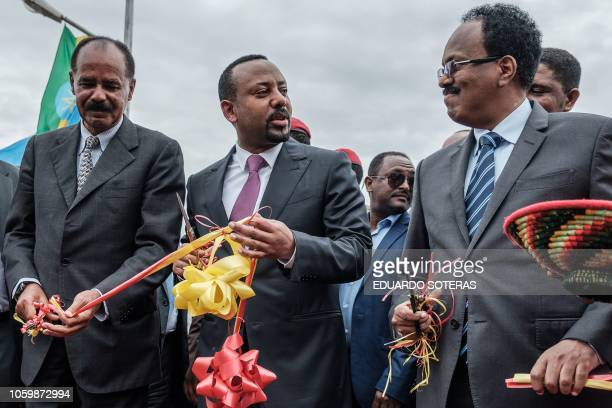 Ethiopia's Prime Minister Abiy Ahmed Eritrea's President Isaias Afwerki and Somalia's President Mohamed Abdullahi Mohamed react after cutting the...