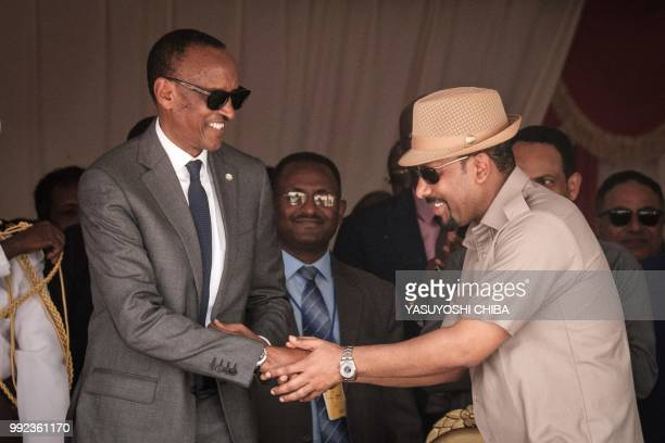 Ethiopia's Prime Minister Abiy Ahmed greets with Rwanda's President Paul Kagame during the inauguration ceremony of Djibouti International Free Trade...