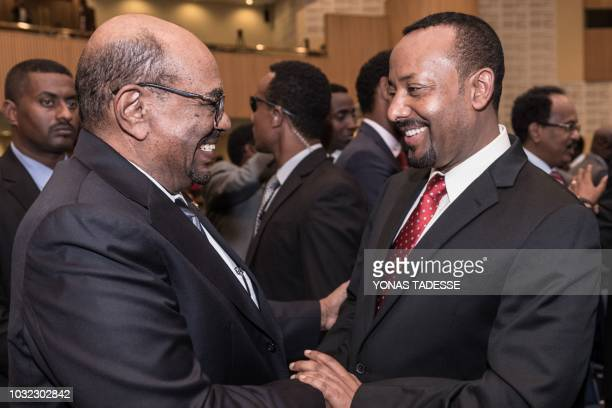 Ethiopia's Prime Minister Abiy Ahmed greets with Sudan's President Omar al-Bashir at the 33rd Extraordinary Summit of Intergovernmental Authority on...