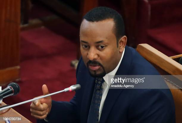Ethiopia's Prime Minister Abiy Ahmed is seen as Ethiopian election authority head Birtukan Mideksa swearing in during the handover ceremony at the...