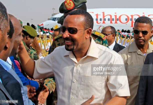 Ethiopia's Prime Minister Abiy Ahmed is welcomed at Khartoum international airport on June 7 2019 Ethiopia's prime minister arrived in Khartoum today...