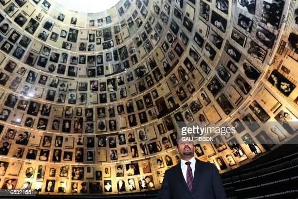 Ethiopia's Prime Minister Abiy Ahmed looks at pictures of Jewish Holocaust victims at the Hall of Names on September 1, 2019 during his visit to the...