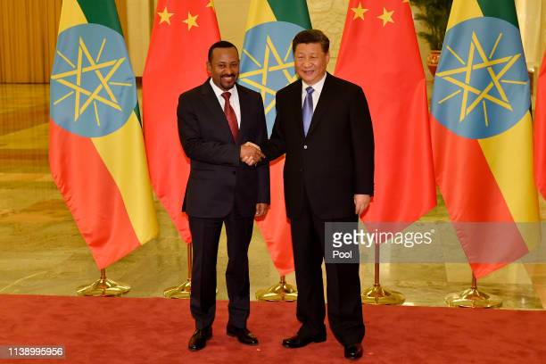 Ethiopia's Prime Minister Abiy Ahmed shakes hands with Chinese president Xi Jinping before their meeting at the Great Hall of the People in Beijing,...