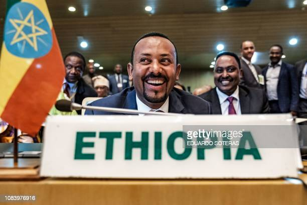 Ethiopia's Prime Minister Abiy Ahmed smiles before a High Level Consultation Meeting with African leaders on DR Congo election at the AU headquarters...