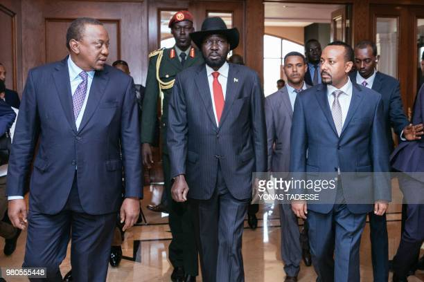 Ethiopia's Prime Minister Abiy Ahmed South Sudan's President Salva Kiir and Kenya's President Uhuru Kenyatta walk prior to the 32nd Extraordinary...