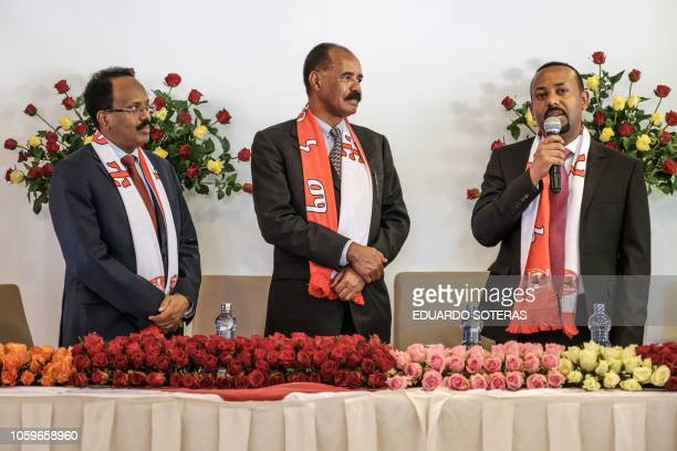 Ethiopia's Prime Minister Abiy Ahmed speaks with Eritrea's President Isaias Afwerki and Somalia's President Mohamed Abdullahi Mohamed during their...