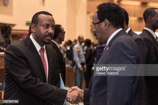 Ethiopia's Prime Minister Abiy Ahmed speaks with Somalia's President Mohamed Abdullahi Mohamed at the 33rd Extraordinary Summit of Intergovernmental...