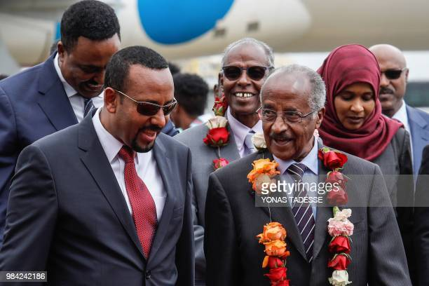 Ethiopia's Prime Minister Abiy Ahmed walks with Eritrea's Foreign minister Osman Saleh Mohammed as Eritrea's delegation arrives for peace talks with...