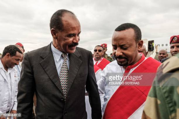 Ethiopia's Prime Minister Abiy Ahmed welcomes Eritrea's President Isaias Afwerki upon his arrival at the airport in Gondar, for a visit in Ethiopia,...