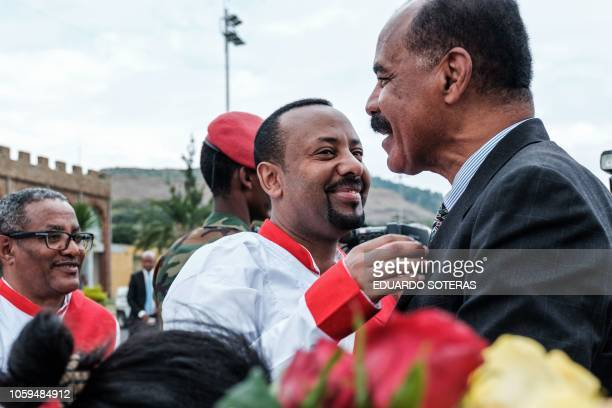 Ethiopia's Prime Minister Abiy Ahmed welcomes Eritrea's President Isaias Afwerki upon his arrival at the airport in Gondar for a visit in Ethiopia on...