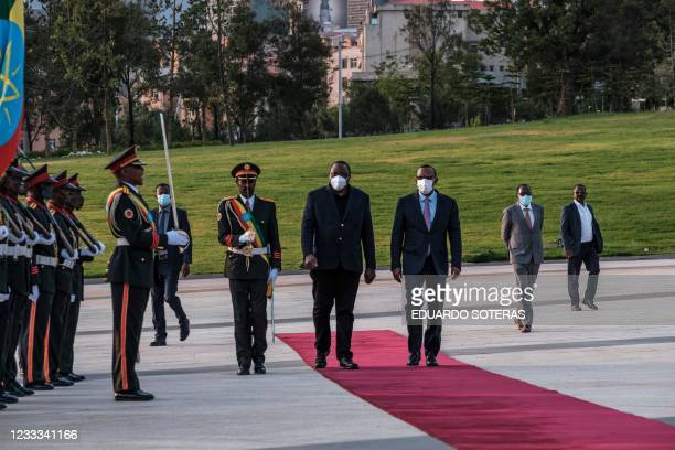 Ethiopia's Prime Minister Abiy Ahmed welcomes President of Kenya Uhuru Kenyatta during a ceremony for the signing of Ethiopias telecom licensing...