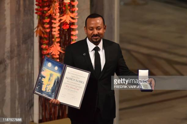 Ethiopia's Prime Minister and Nobel Peace Prize Laureate Abiy Ahmed Ali poses after he was awarded the Nobel Peace Prize during a ceremony at the...