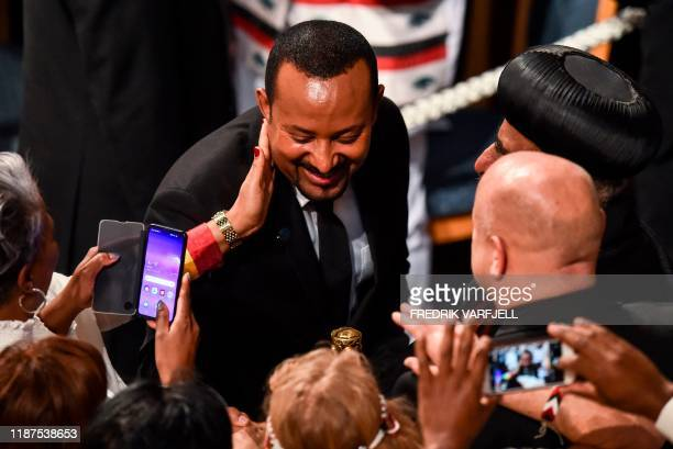 Ethiopia's Prime Minister and Nobel Peace Prize Laureate Abiy Ahmed Ali is greeted by well wishers after receiving the Nobel Peace Prize during a...