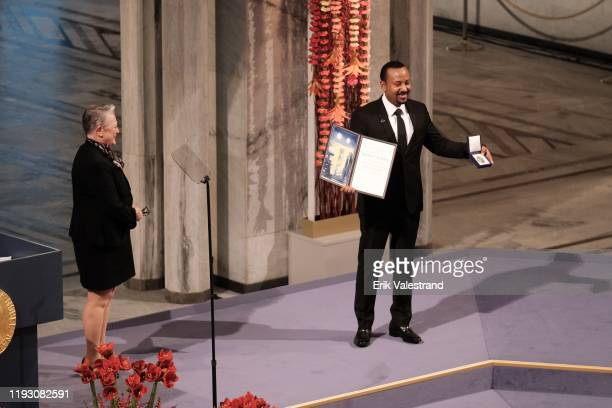 Ethiopia's Prime Minister and Nobel Peace Prize Laureate Abiy Ahmed Ali receives the Nobel Peace Prize award from Berit Reiss-Andersen Head Nobel...