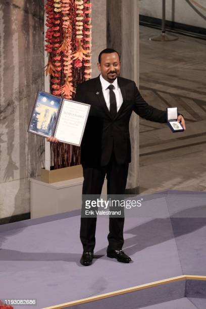 Ethiopia's Prime Minister and Nobel Peace Prize Laureate Abiy Ahmed Ali poses after being awarded with the Nobel Peace Prize during the Nobel Peace...