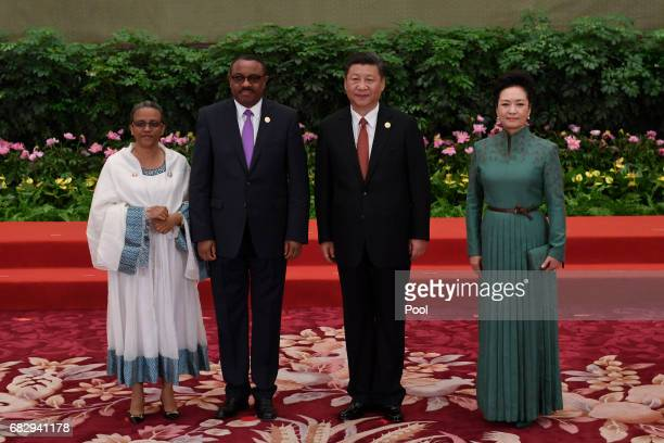 Ethiopia's Prime Minister Hailemariam Desalegn and his wife Roman Tesfaye pose with Chinese President Xi Jinping and his wife Peng Liyuan during a...