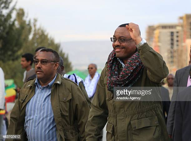Ethiopia's Prime Minister Hailemariam Desalegn and Tigray Region President Abay Woldu walk to Martyr's Memorial Monument on February 17 2015 in...