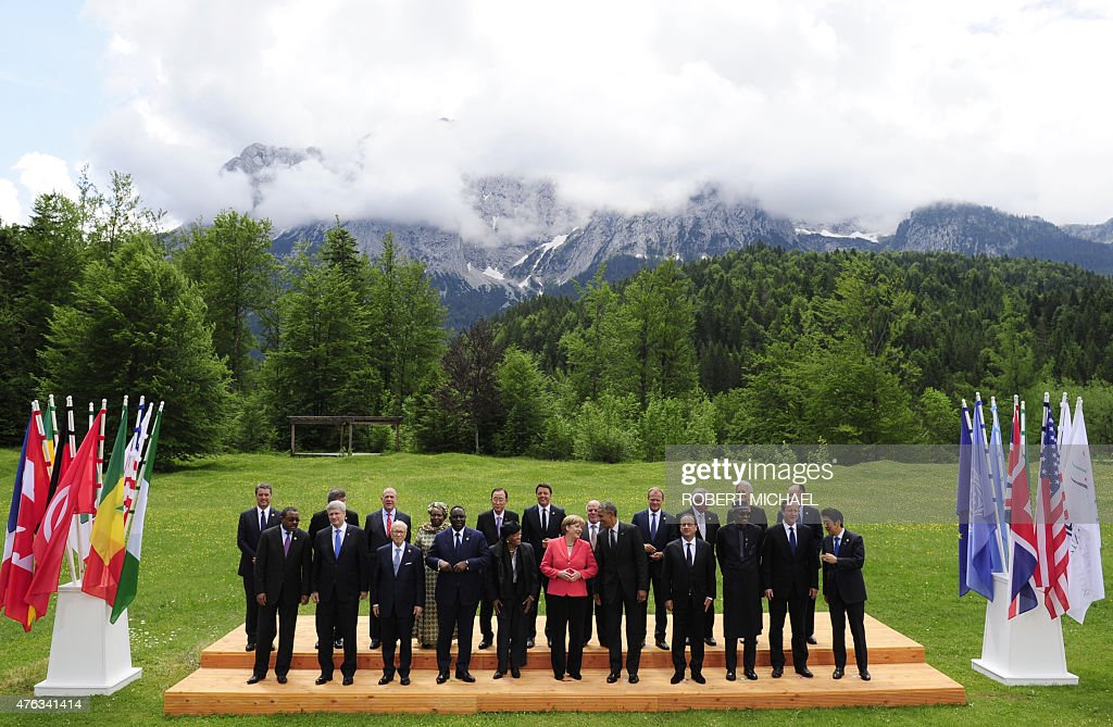 Ethiopia's Prime Minister Hailemariam Desalegn, Canada's Prime Minister Stephen Harper, Tunisia's President Beji Caid Essebsi, Senegal's President Macky Sall, Liberia's President Ellen Johnson Sirleaf, Germany's Chancellor Angela Merkel, US President Barack Obama, French President Francois Hollande, Nigerian President Muhammadu Buhari, British Prime Minister David Cameron and Japanese Prime Minister Shinzo Abe (2nd row L-R) Director-General of the World Trade Organization Roberto Azevedo, OECD secretary general Jose Angel Gurria, Chair of the Commission of the African Union Dlamini Zuma, United Nations Secretary-General Ban Ki-moon, Italy's Prime Minister Matteo Renzi, Iraq's Prime Minister Haider al-Abadi, President of the European Council Donald Tusk, European Union Commission President Jean-Claude Juncker, IMF Managing Director Christine Lagarde and World Bank Group President Jim Kim pose for the traditional family picture after a so-called 'outreach meeting' at the Elmau Castle near Garmisch-Partenkirchen, southern Germany, on June 8, 2015 on the second day of the end of a G7 summit. Germany hosts a G7 summit at the Elmau Castle on June 7 and June 8, 2015.